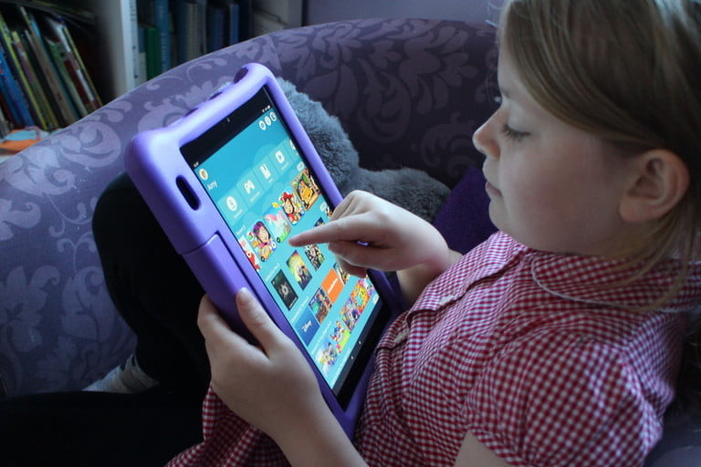kid playing on tablet