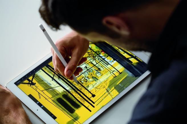 man working on an ipad