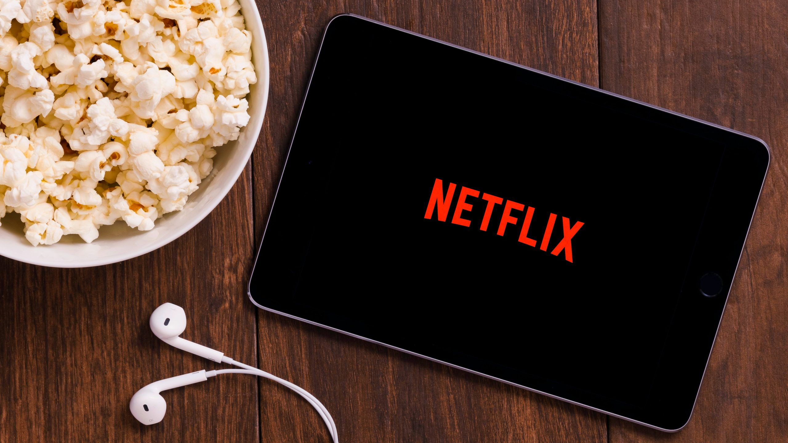 netflix on a tablet and popcorn